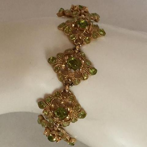 Gold Plated Bracelet W/Group of Light Green Peridot Coloured Gemstones - Roadshow Collectibles