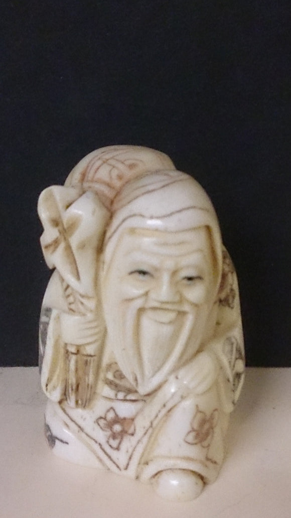 Netsuke, Carved Bone, a Bearded Old Man Holding a Sack, Japanese - Roadshow Collectibles