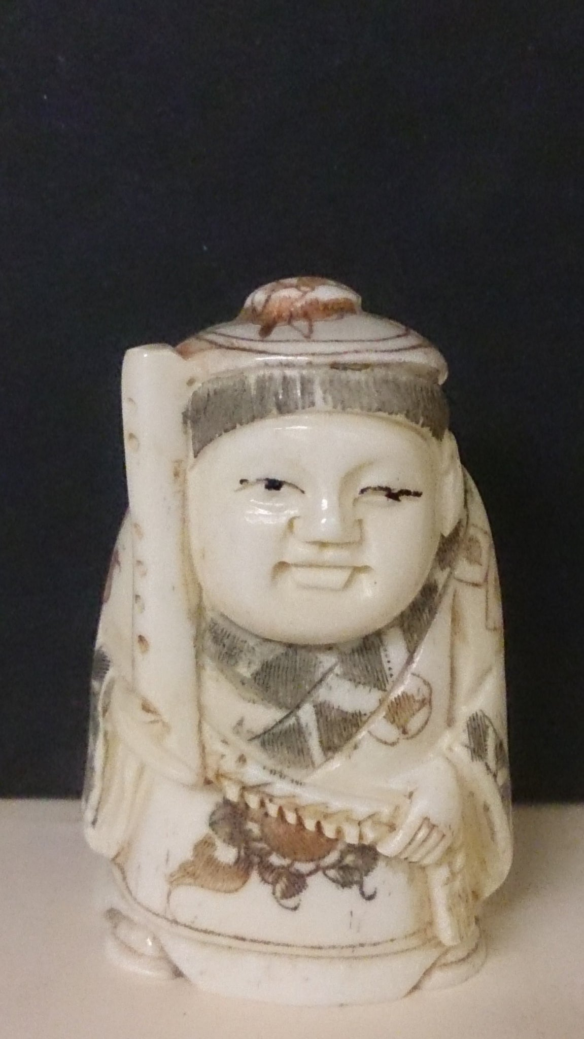 Netsuke Carved Bone A Man Wearing A Hat Carrying A Flute Japanese Roadshow Collectibles