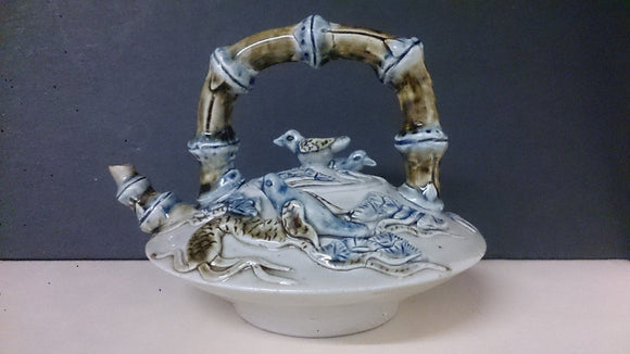Porcelain Teapot Embossed Birds Flowers Plants Black Brown Blue Accents - Roadshow Collectibles