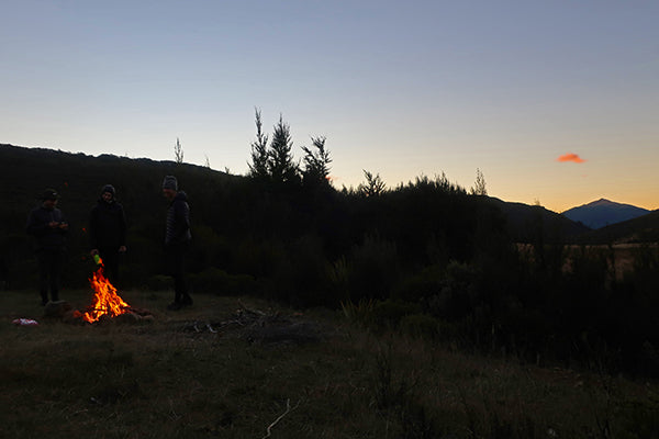 Sun set over the fire at Red Hills Hut Richmond Ranges