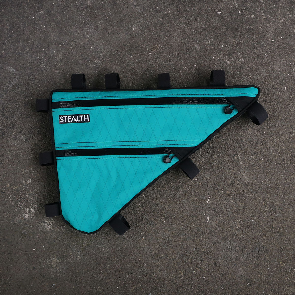 Custom Teal X-pac frame bag for bikepacking tour divide