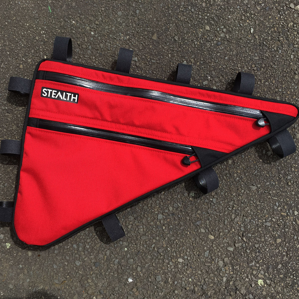 Bright red frame bag for bike packing