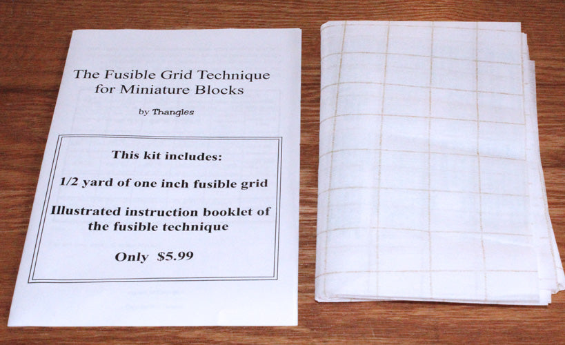 "Thangles Mini block technique book with 1/2 yd fusible printed with 1"" grid"