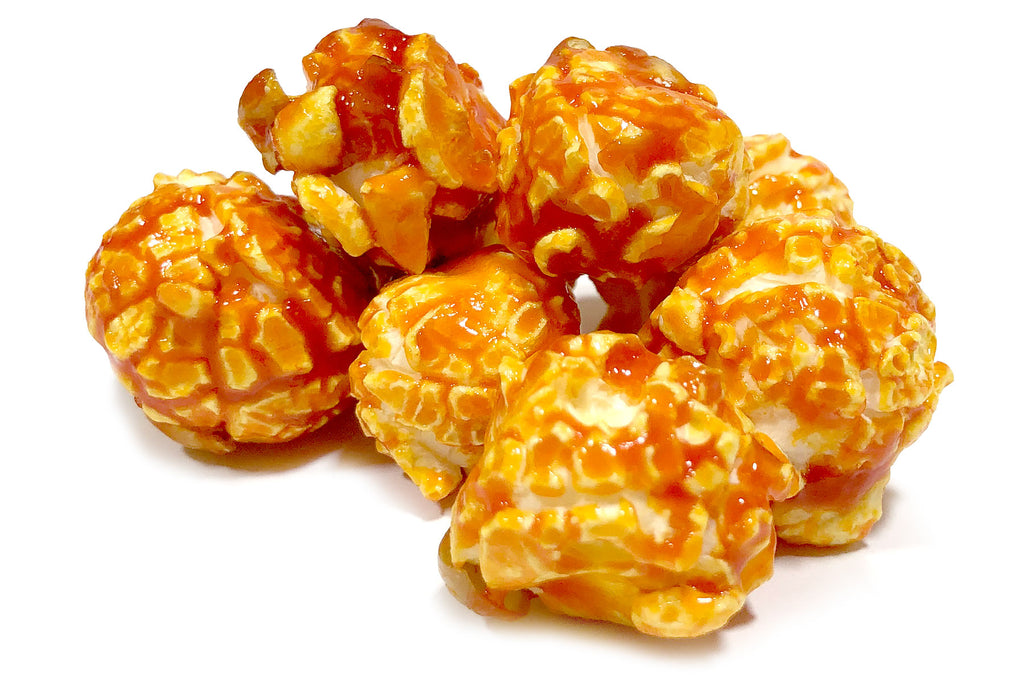 Buy fresh, peach flavored popcorn online (available in tins or bags), and have your gourmet popcorn order shipped anywhere in the Continental US.