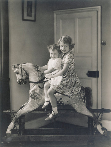 Queen Elizabeth and Princess Margaret Riding on a Rocking Horse