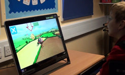Child playing an Eye Can Fly activity using eye gaze