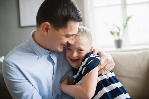 Father hugging child