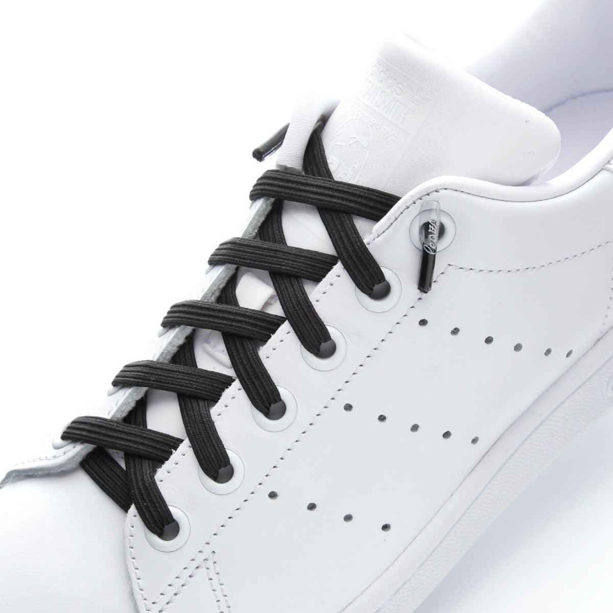 Image result for white shoes with black shoelaces