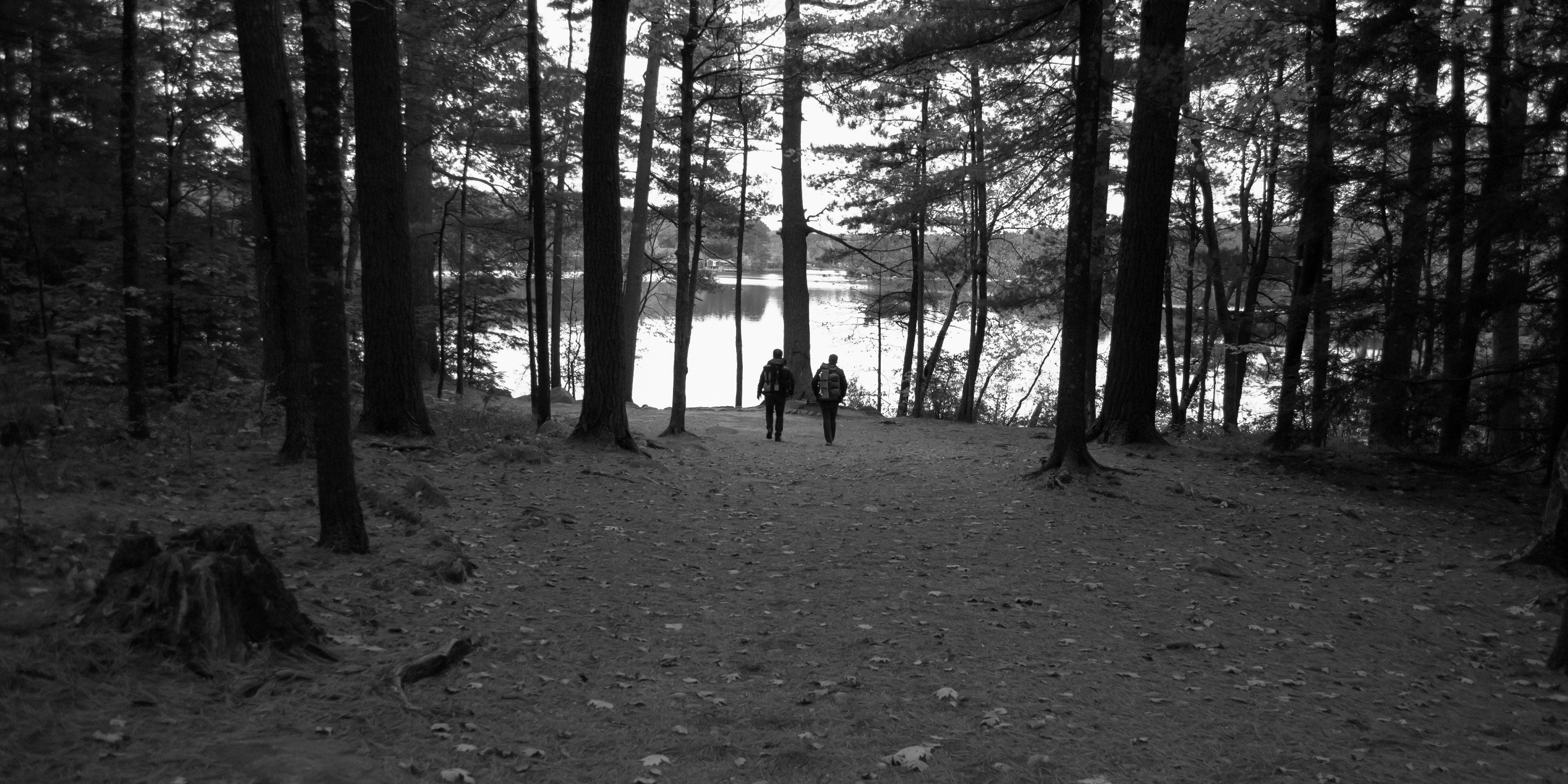 Concept 91 Co-Founders Ben and Jesse hike towards a campsite.