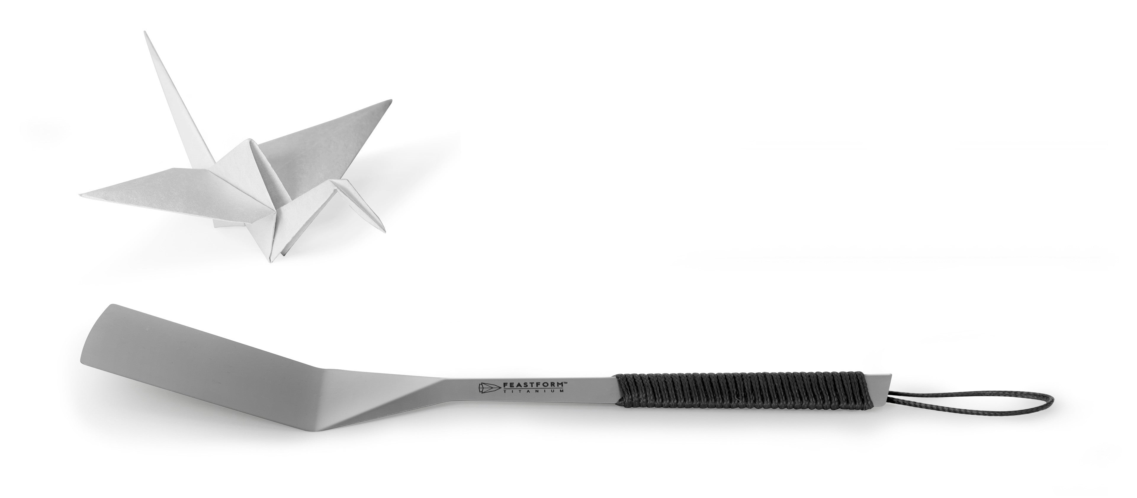 Feastform titanium camping spatula and paper crane. Inspired by origami.