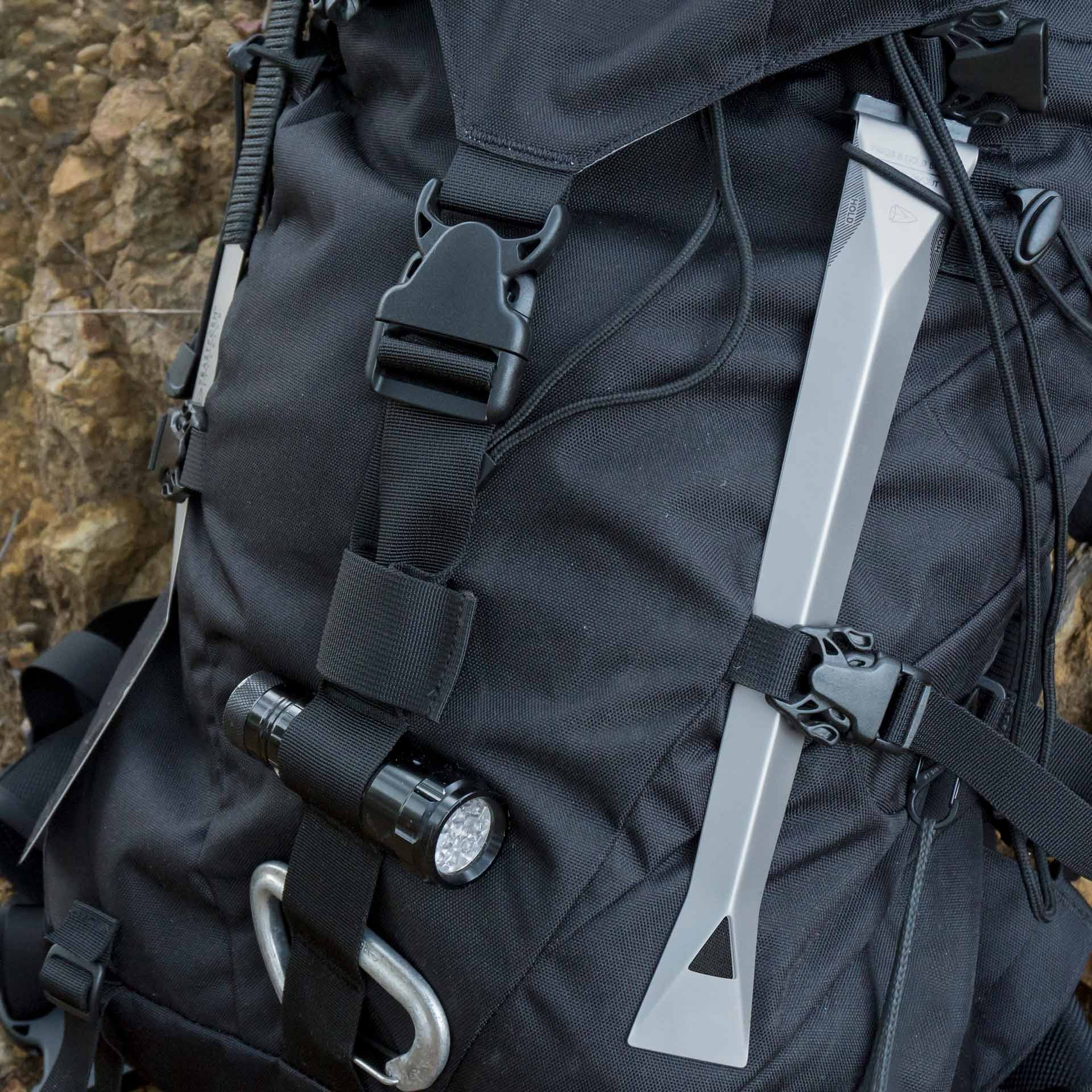 Lightweight nested Feastform titanium camping tongs strapped to backpack.