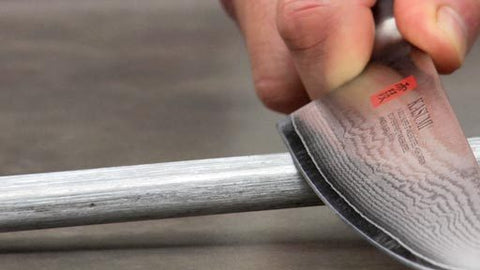 Hone a chef knife with honing steel