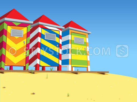 A series of beach huts on the sandy beach.
