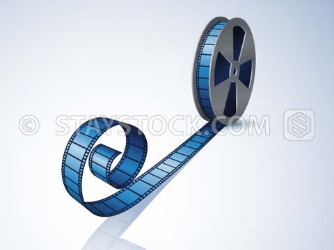 A reel of film on its side with some movie film extending out.