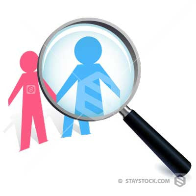 A paper people cutout Couple Magnified under a magnifying glass.