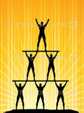 A silhouette of a human pyramid of men in victory poses.