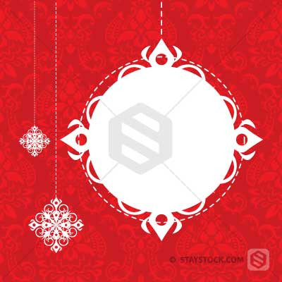 Some elegant snowflakes and a decorative bauble forming a Christmas card background.