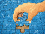 Illustrated jigsaw Puzzle with a hand putting the final piece in place.