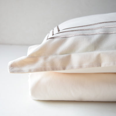 Parallel Cream Cotton Sateen Bed Sheet by Veda Homes