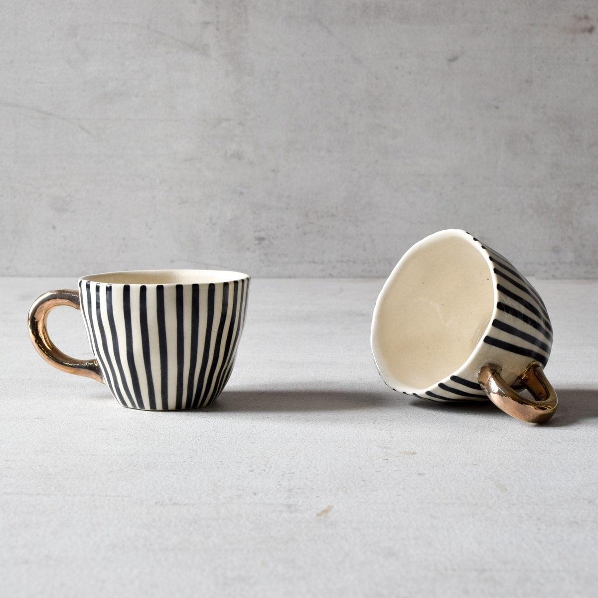 Ella Black Vertical Striped Ceramic Cup with Golden Handle