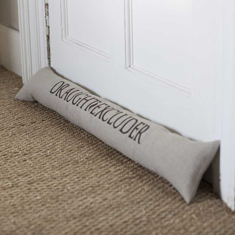 "Draft excluder with the embroidery ""Draught Excluder"""