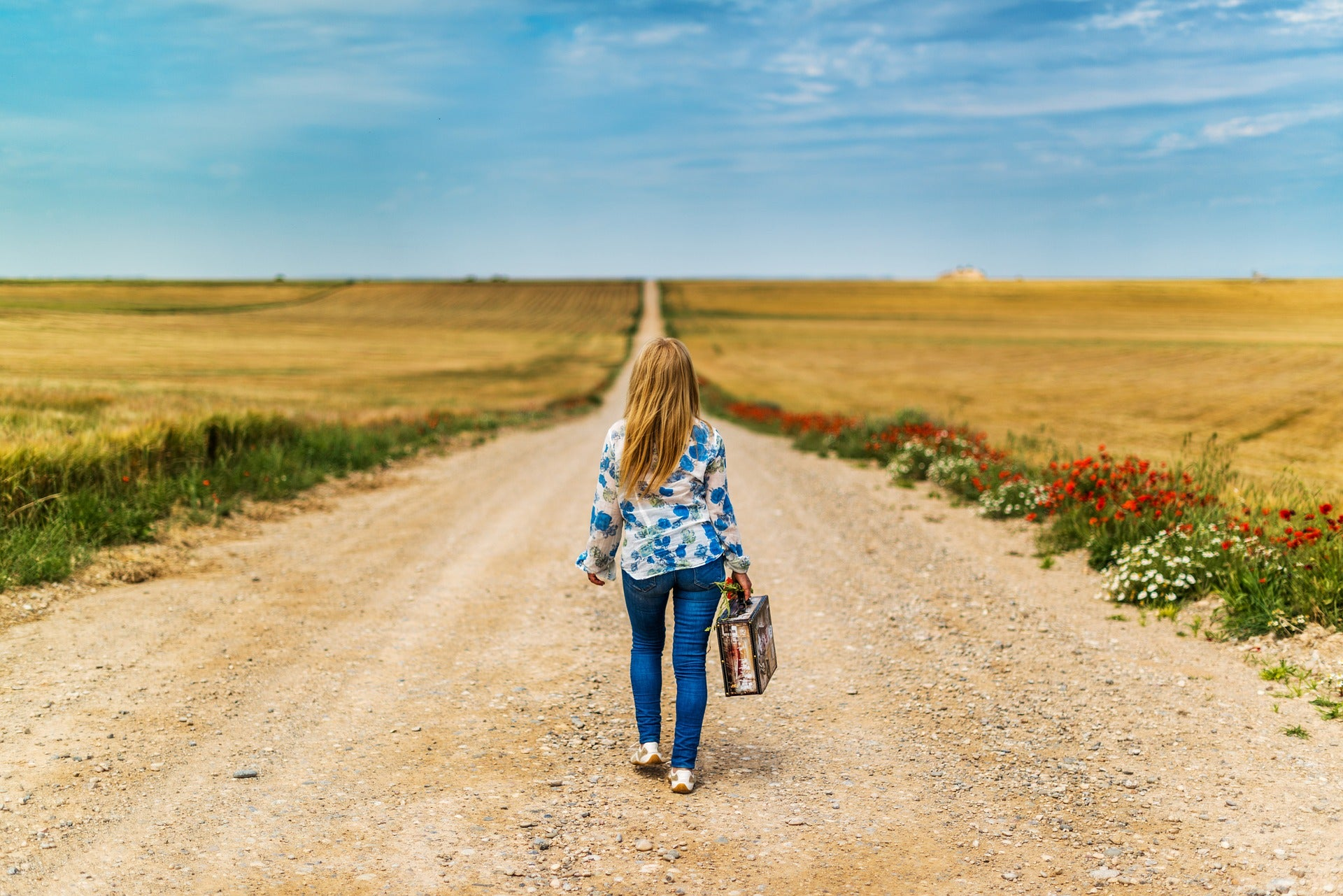 Girl walking on an open road