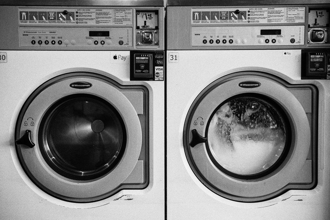 Wash clothes while travelling in a laundromat