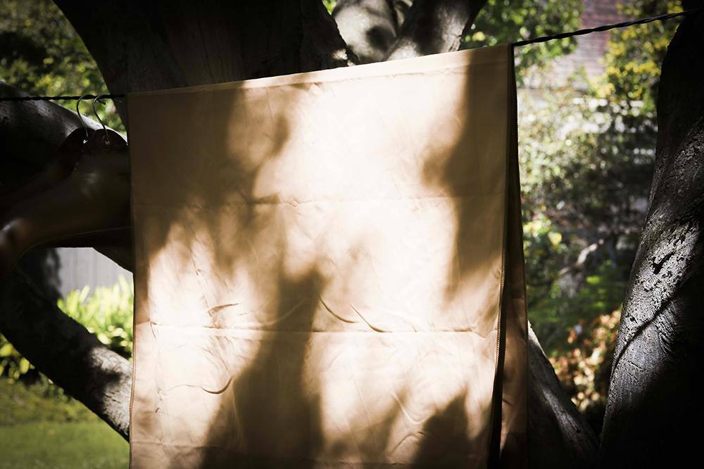 Scrubba Tactical Towel Hanging in shade