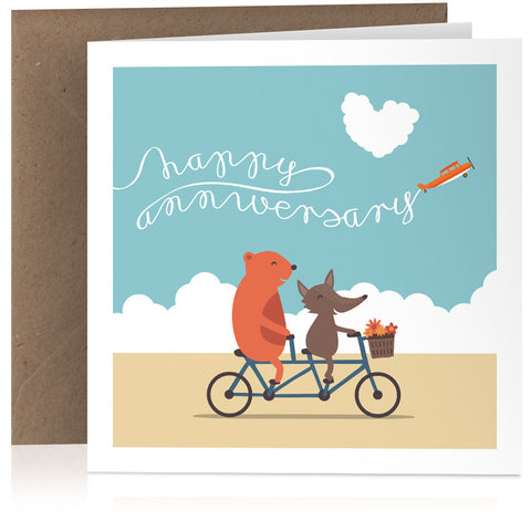 Cute illustrated anniversary card with animals riding a tandem bike
