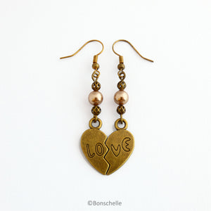 Antique bronze toned split heart earrings with the word LOVE, Swarovski peach coloured pearls, bronze toned beads and earwires 1
