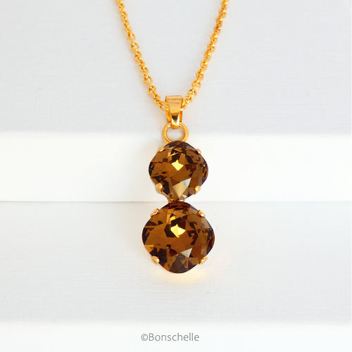 front view of Bronze toned couble cushion cut crystal necklace for women
