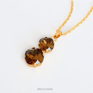 side view of Bronze_Topaz_cushion_cut_crystal_necklace_1.jpg  1000 × 1000px  Bronze toned couble cushion cut crystal necklace for women