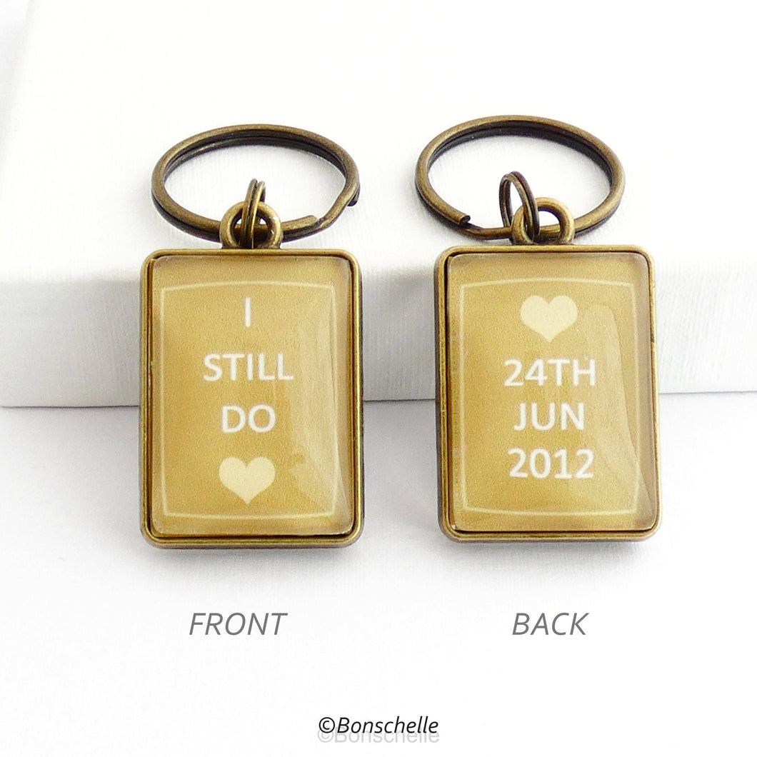 bronze toned metal and glass cabochon rectangle shape keyring for bronze anniversary with personalised date and the worlds I still do