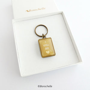 gift box view of the bronze toned metal and glass cabochon rectangle shape keyring for bronze anniversary with personalised date and the worlds I still do
