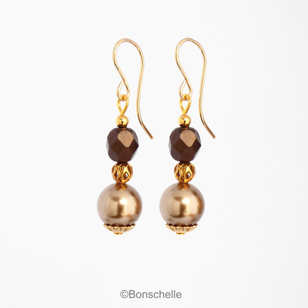Handmade earrings made with light bronze swarovksi simulated pearls, dark bronze faceted glass beads, small gold toned beads and 14K gold filled earwires.