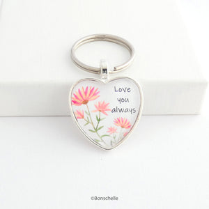 Heart shaped silver keyring with pink and peach flowers flower design and the words Love You Always on the front capped with a clear glass cabochon.