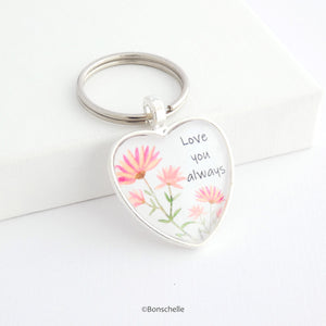 Heart shaped silver keyring with a cute flower design and the words Love You Always on the front capped with a clear glass cabochon.