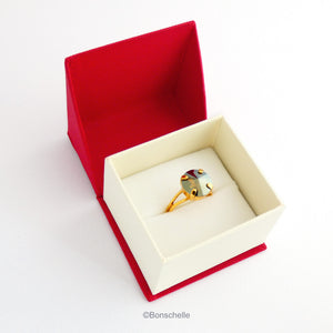 The 24K gold plated solitaire ring for women with a deep bronze Swarovksi crystal stone shown in the jewellery box.