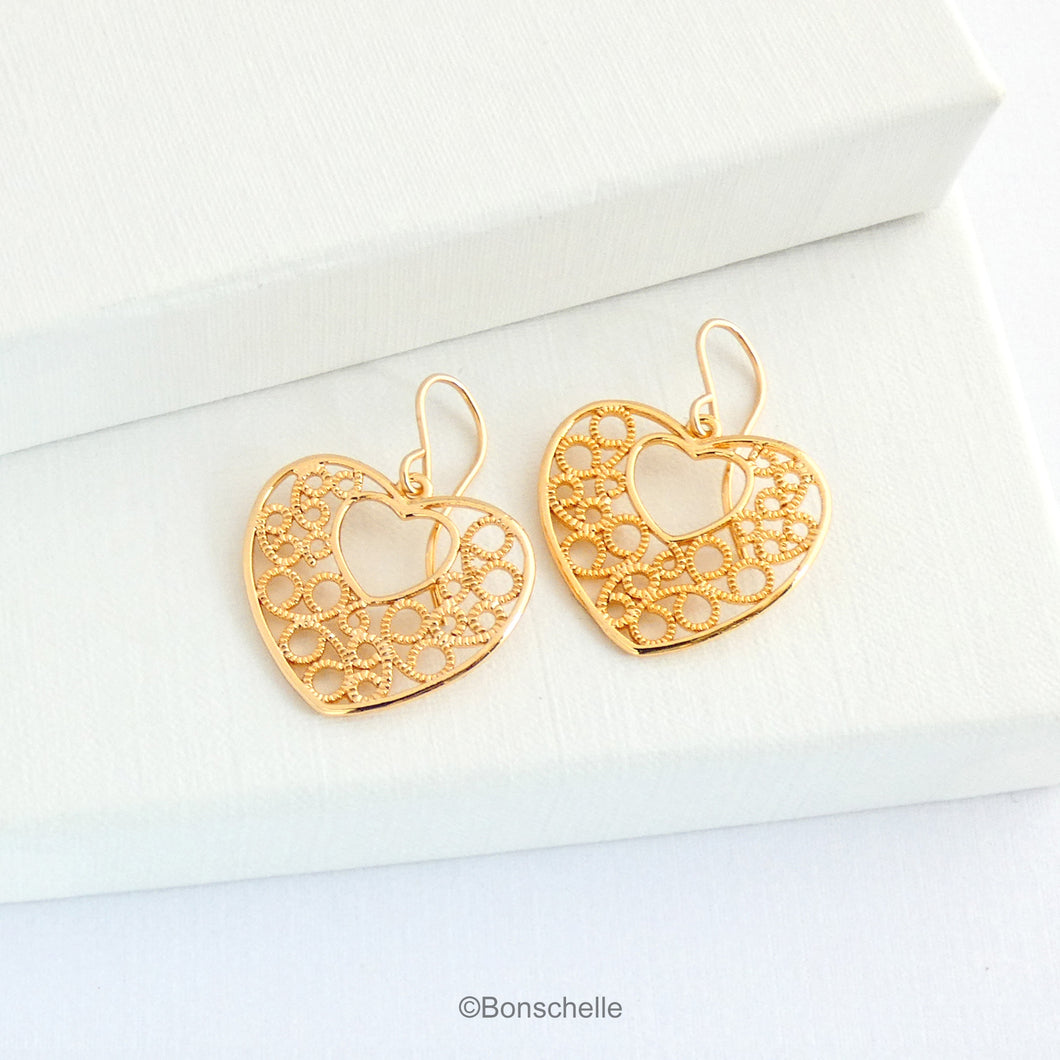 18K gold plated filigree heart earrings with 14K gold filled earwires shown on a jewellery box