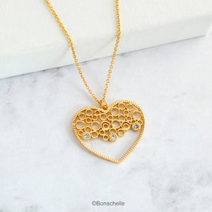 18K gold plated filligree heart with 3 tiny cubic zirconia and a 14K gold filled chain