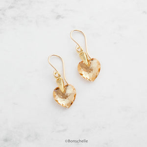 Handmade earrings with pale golden bronze toned Swarovski crystal heart earrings and 14K gold filled earwires .