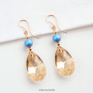 alternative view of handmade drop earrings with pale bronze toned swarovski crystal glass cut teardrop beads, plae blue irridescent crystal pearls , gold toned beads and 14K gold filled earwires