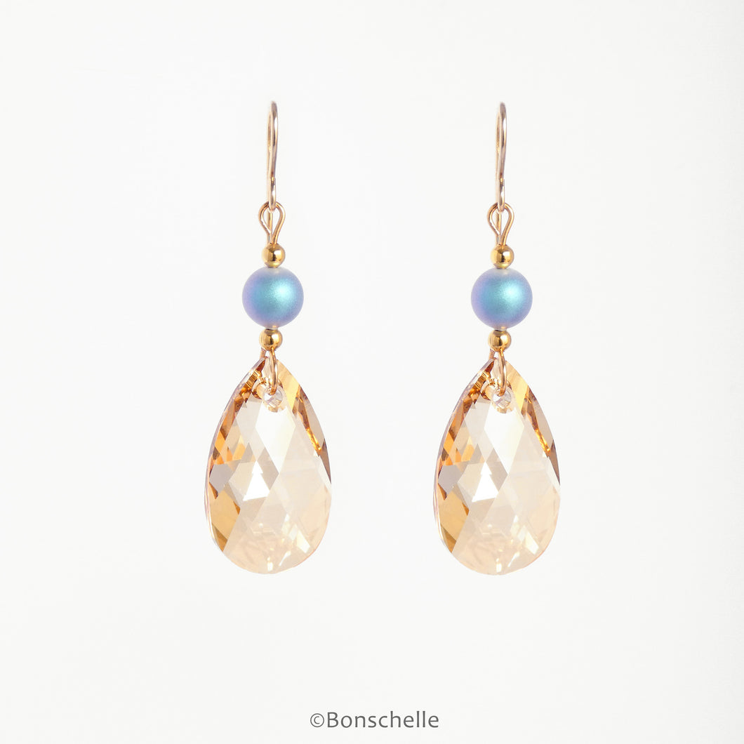 handmade drop earrings with pale bronze toned swarovski crystal glass cut teardrop beads, plae blue irridescent crystal pearls , gold toned beads and 14K gold filled earwires