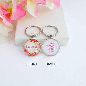 Another view of Double sided silver toned round keyring with a name and floral design on the front and your custom text on the back.