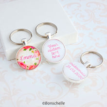 Load image into Gallery viewer, Double sided silver toned round keyring with a name and floral design on the front and your custom text on the back showing an additonal example of text on the back.