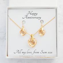 Load image into Gallery viewer, handmade necklace and earrings jewellery set for women made with pale gold colour crystal cut Swarovski heart beads, 14K gold filled chain and 14K gold filled earwires shwon in a jewellery box with a personalised gift message