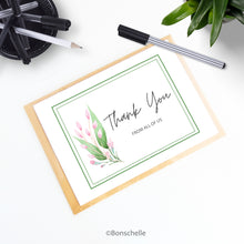 Load image into Gallery viewer, Handmade personalised Thank you card with pink buds and green leaves and custom text under the words 'Thank You. Floral blank inside thank you greeting card shown with a brown envelope on a desk