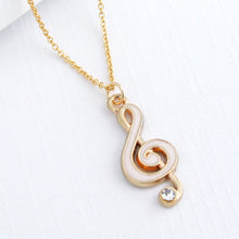 Load image into Gallery viewer, Pink enamel and gold treble clef shaped pendant with faux diamond and gold  necklace chain