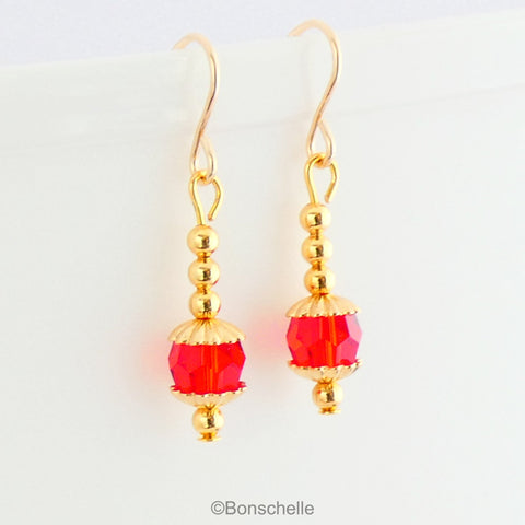 red swarovski crystal and gold toned bead earrings 1